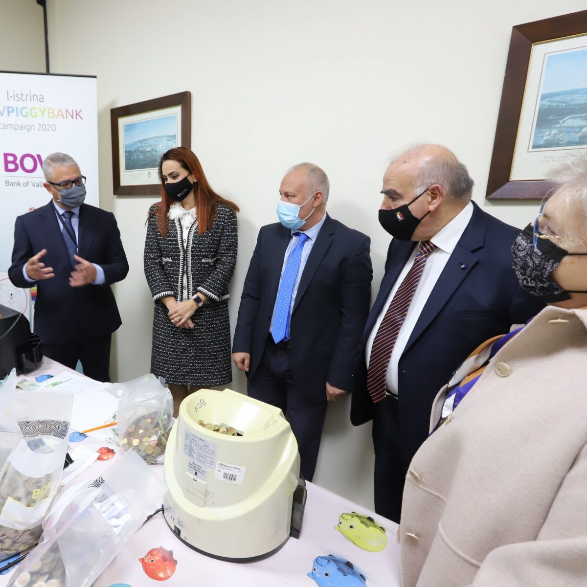 President and Mrs Vella visit Piggy Bank Campaign Coin Counting